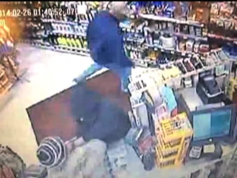an armed robber gets the tables turned on him in a hurry when a store employee takes him down to the ground - oblivious stock videos & royalty-free footage
