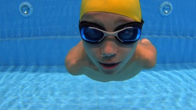 an armless afghan boy inspiring other migrants after being successful at swimming with only having one arm 10yearold omran mohammed majidzade flees... - studying stock videos & royalty-free footage