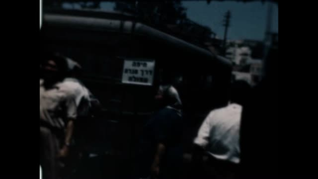 stockvideo's en b-roll-footage met an armored bus prepares to take civilians out of jerusalem just after the war of independence / sign on the bus says haifa by way of afula - israëlisch leger