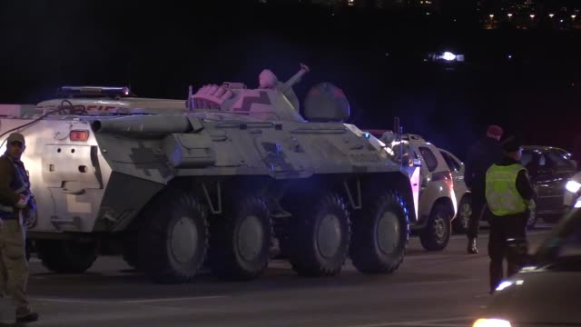 an armored car seen after an operation of ukrainian special forces for detain a man who was threatening to blow up a major bridge over the dnipro... - carbine stock videos and b-roll footage