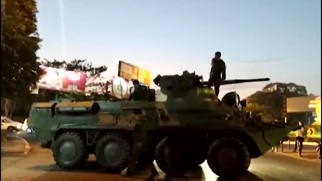 an armored vehicle is seen driving around yangon while drivers honk to express their anger - armé bildbanksvideor och videomaterial från bakom kulisserna