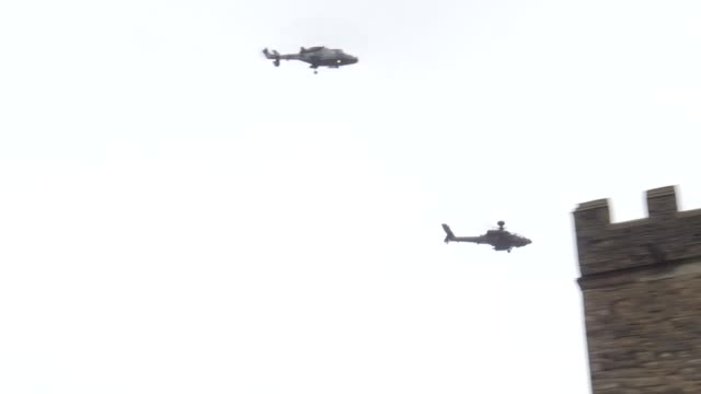an army air corps flypast featuring a wildcat and an apache attack helicopter commemorate captain tom moore's 100th birthday over the heroic... - attack helicopter stock videos & royalty-free footage