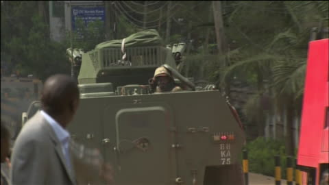 an army tank responds to the westgate mall in nairobi, kenya during the 2013 attack on that location by the terrorist group al-shabaab. - war or terrorism or military stock videos & royalty-free footage