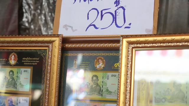 an arrangement of thai baht notes featuring the late thai king bhumibol adulyadej stands on display at a stall in bangkok thailand on saturday oct 21... - king of thailand stock videos and b-roll footage
