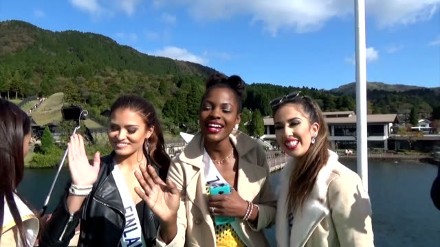 An array of beauty queens strutted through sightseeing spots at this hot spring town to put it back on the tourist map after volcanic activity blew a...