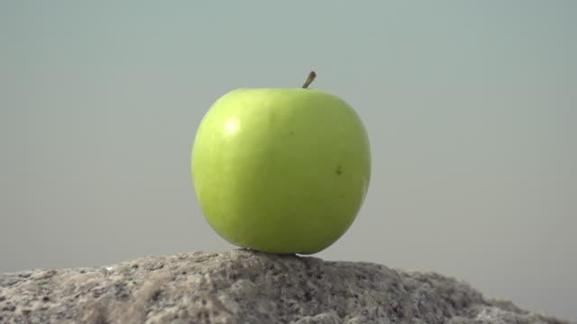 An arrow hitting an apple. - Slow Motion - filmed at 480 fps