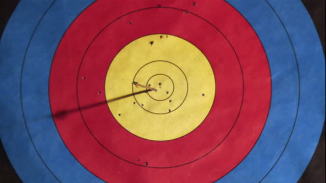 an arrow pierces the center of a target. - sports equipment stock videos & royalty-free footage