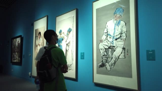 CHN: Art exhibition showcases China's fight against COVID-19
