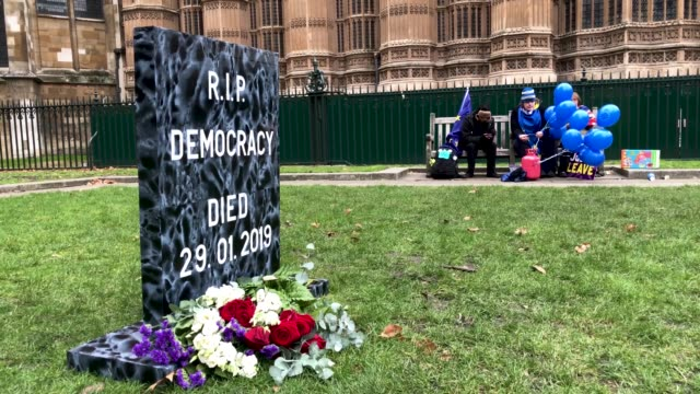 an artificial gravestone reading 'rip democracy died ' on january 29, 2019 in london, england. mps debate the amendments to the prime minister's... - fake stock videos & royalty-free footage