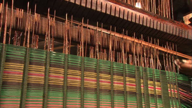 an artisan threads rushes into a loom. - loom stock videos & royalty-free footage