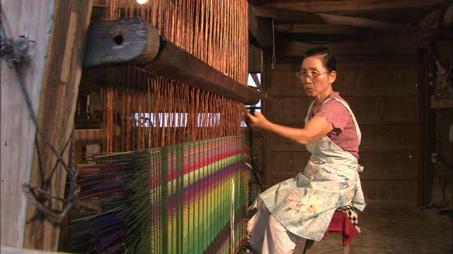 an artisan works on her loom. - fukuoka prefecture stock videos & royalty-free footage