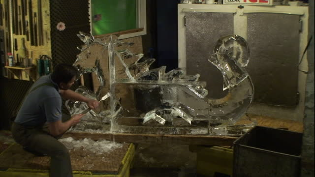 An artist carves a dragon-horse ice sculpture.