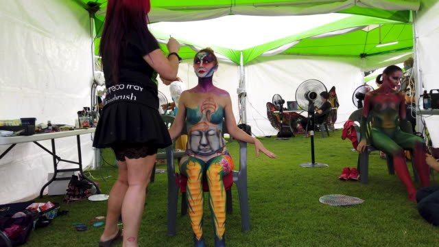 an artist paints a model during the 2019 daegu international bodypainting festival on august 25 2019 in daegu south korea the festival is the largest... - daegu stock videos and b-roll footage