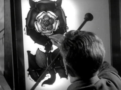 an artist paints a tudor rose onto a glass panel which will make up a section of a new stained glass window for westminster hall - rose window stock videos and b-roll footage