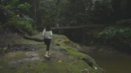 an asian chinese beautiful woman jungle trekking