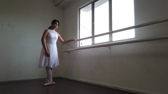 an asian chinese female ballet dancer practicing in dance studio and fell down on the floor - ballet shoe stock videos & royalty-free footage