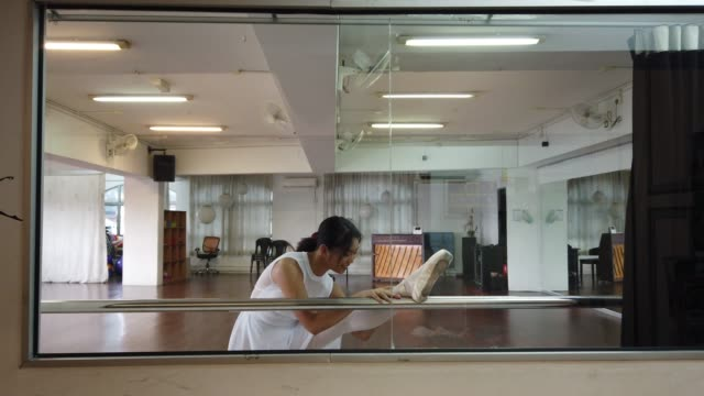 an asian chinese female ballet dancer practicing in dance studio and getting herself ready - ballet studio stock videos & royalty-free footage
