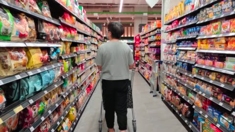 an asian chinese female wearing a mask going out shopping in supermarket buying grocery - malaysian culture stock videos & royalty-free footage