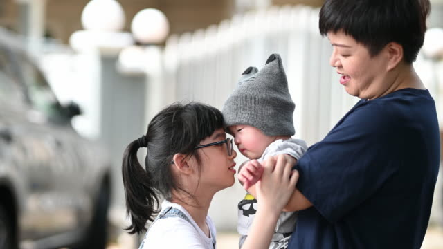 an asian chinese mother playing with her baby boy outdoor during weekend together - single mother stock videos & royalty-free footage