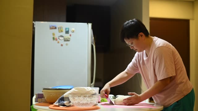 an asian chinese stay home mother preparing dough - three quarter length stock videos & royalty-free footage
