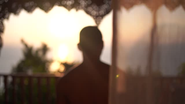 an asian man walking in a room while the sun is going down. - beautiful people stock videos & royalty-free footage