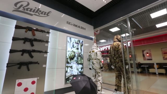 an assault weapon logo sits on display inside the kalashnikov concern jsc store at sheremetyevo airport in moscow russia on thursday aug 25 a... - schusswaffe stock-videos und b-roll-filmmaterial