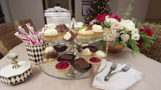 An assortment of delicious desserts decoratively displayed for a Holiday/Christmas party