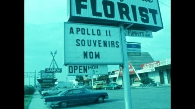an assortment of signs welcoming spectators of the apollo 11 launch in cocoa beach, florida. - 1960 1969 stock videos & royalty-free footage