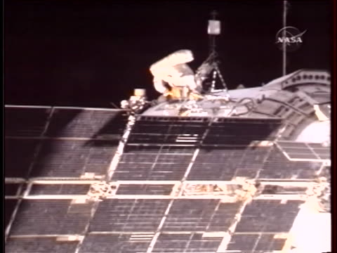 an astronaut makes repairs on the international space station as it orbits the earth - orbiting stock videos & royalty-free footage