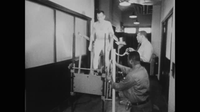 an astronaut's heartrate is measured as he walks on a treadmill - 1958年点の映像素材/bロール