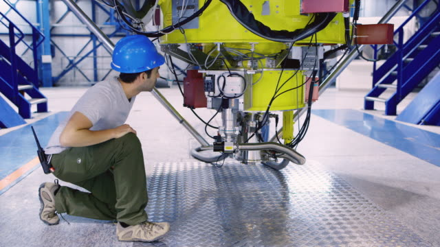 MS An astronomer inspects one of the VLT telescopes at Paranal Observatory / Chile