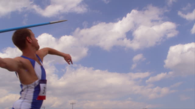 an athlete throws a javelin into the air. - sportsperson stock videos & royalty-free footage