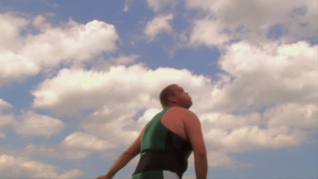 An athlete throws a javelin into the air.