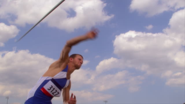 An athlete throws a javelin.