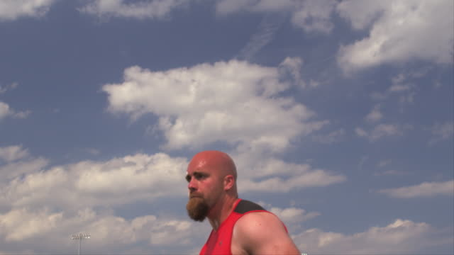 an athlete throws a shot put ball. - completely bald stock videos and b-roll footage