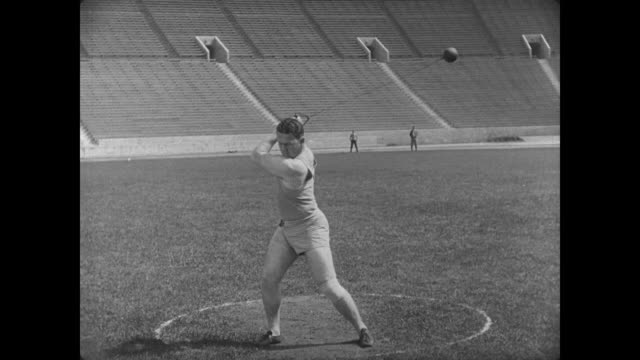 1927 An athletic student successfully performs the hammer throw