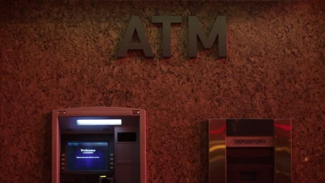 an atm machine is seen outside a bank april 1, 2020 in washington, dc. the district of columbia has joined other states and territories, including... - maryland stato video stock e b–roll