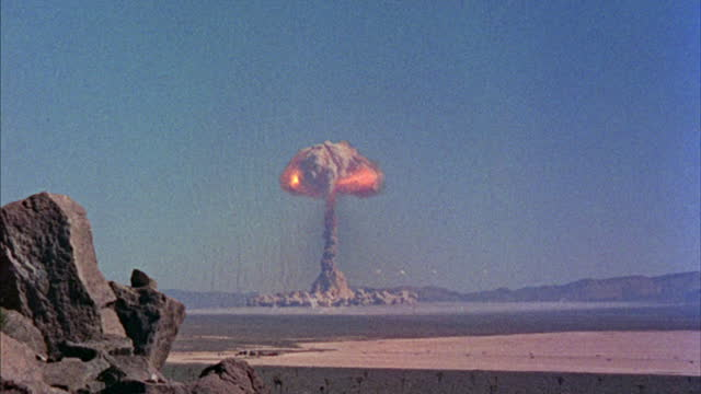 an atom bomb explodes in the desert. - weapons of mass destruction stock videos & royalty-free footage