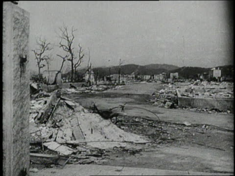 an atomic bomb explodes leaving nagasaki in ruins - bombing stock videos & royalty-free footage