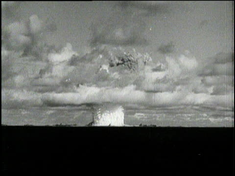 An atomic mushroom clouds spreads over the Pacific Ocean