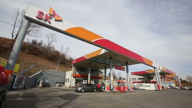 an attendant refuels an automobile at an sk energy co gas station a unit of sk innovation co in incheon south korea on tuesday jan 31 a petrol pump... - gas station attendant stock videos and b-roll footage
