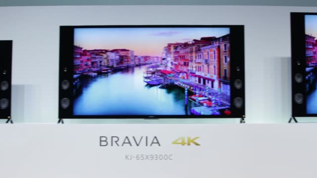 WS An attendant walks past a Bravia logo WS RL Sony Corp Bravia 4K liquid crystal display televisions MS Pan LR Sony Corp Bravia 4K liquid crystal...