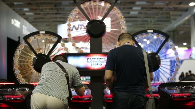 an attendee plays a slot machine at the international game technology booth at the global gaming expo inside the venetian macao resort and casino,... - macao stock videos & royalty-free footage