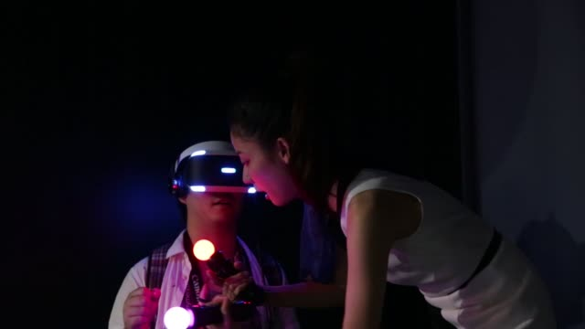 stockvideo's en b-roll-footage met an attendee plays a video game on a sony corp. playstation vr headset at the tokyo game show 2015 at makuhari messe in chiba, japan, on friday, sept.... - television game show