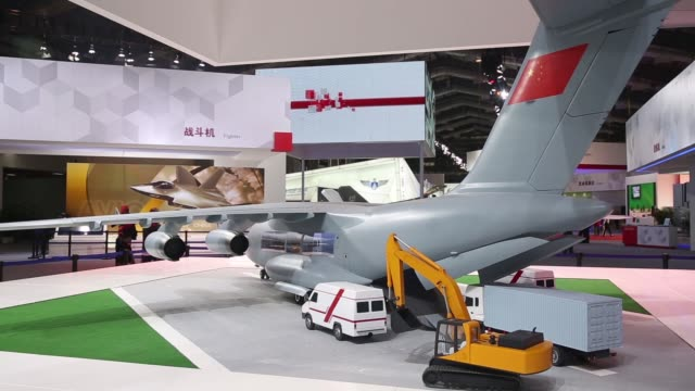 an attendee walks past signage for aviation industry corp of china during the china international aviation aerospace exhibition in zhuhai guangdong... - drone pilot stock videos and b-roll footage