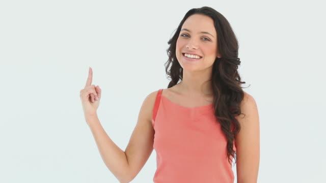 vidéos et rushes de girl raising her index finger - membres du corps humain