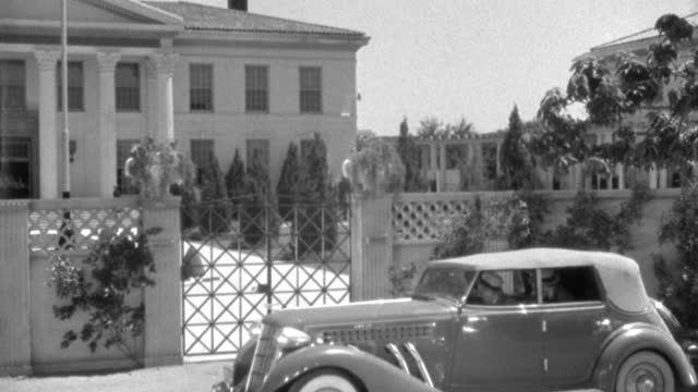 an auburn phaeton arrives at the entrance of a colonial college campus. - 1935 stock videos & royalty-free footage