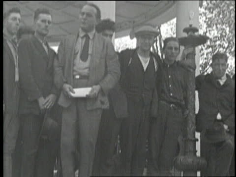 an auction buyer pays a jobless man during the great depression - 1929 stock videos & royalty-free footage