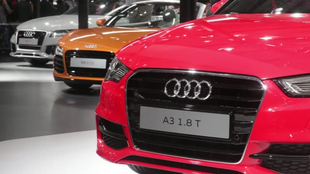 An Audi AG R8 V10 vehicle sits on display at the 12th Auto Expo 2014 in Noida India on Friday Feb 7 General views an Audi AG A3 Cabriolet 18T vehicle...