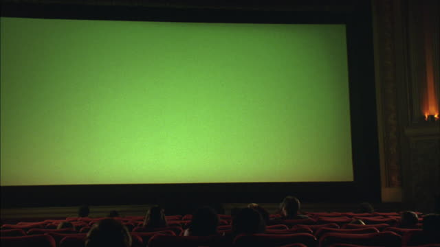 an audience watches a green screen at the grand lake theater in oakland, california. - movie theater stock videos & royalty-free footage
